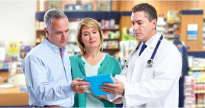 Pharmacist and a couple durign their consultation
