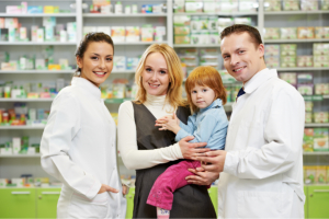 Pharmacist together with a mother and her child